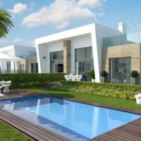 Новые смежные дома, построенные в современном стиле.